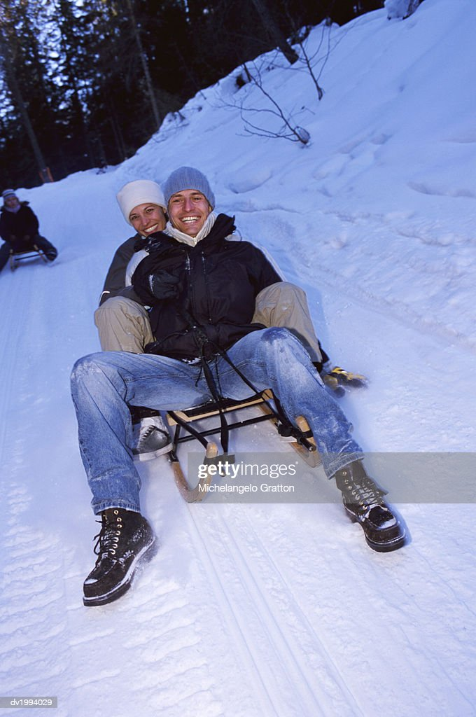 Couple Riding on a Sledge : Stock Photo