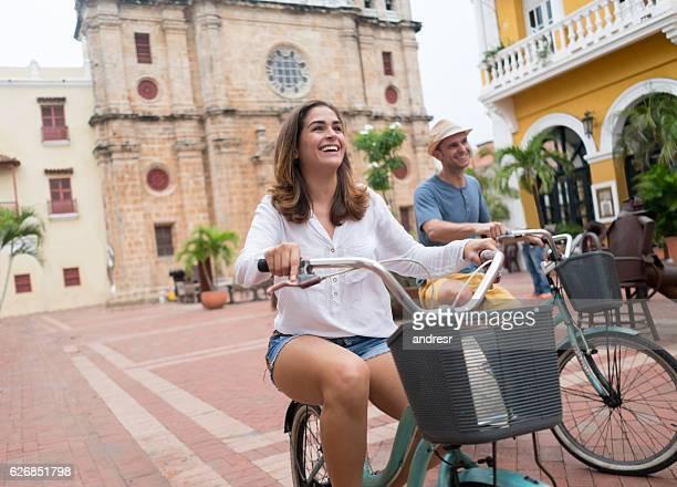 Couple riding on bikes in Cartagena