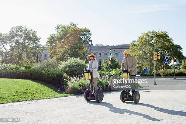 Couple riding segway on sidewalk, Philadelphia, Pennsylvania, USA