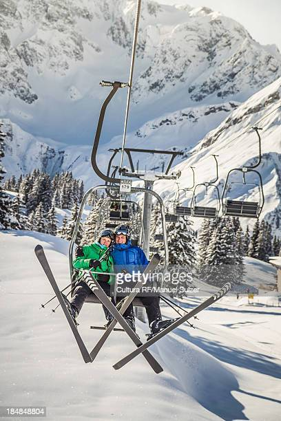 Couple riding ski lift, Warth, Vorarlberg, Austria