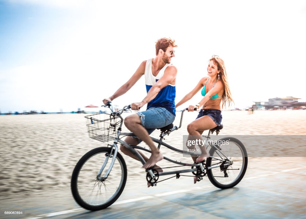 Couple riding tandem bicycle in LA : Stock Photo