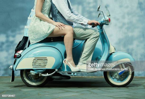 couple riding vintage scooter - blue shoe stock pictures, royalty-free photos & images