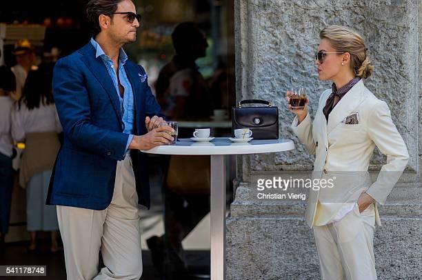 Couple Roberto Mararo and Eleonora Sebastiani drinking Italian coffee outside Jil Sander during the Milan Men's Fashion Week Spring/Summer 2017 on...