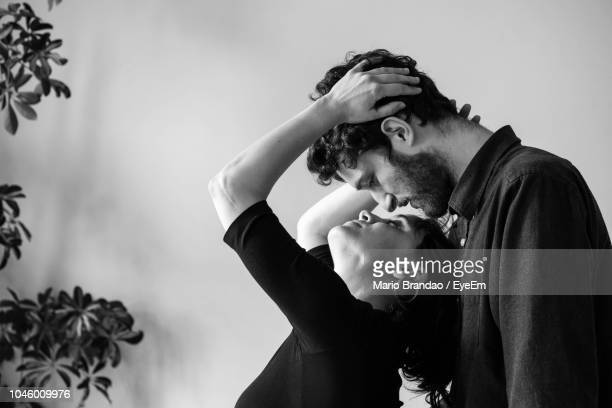 couple romancing at home - heterosexual couple imagens e fotografias de stock