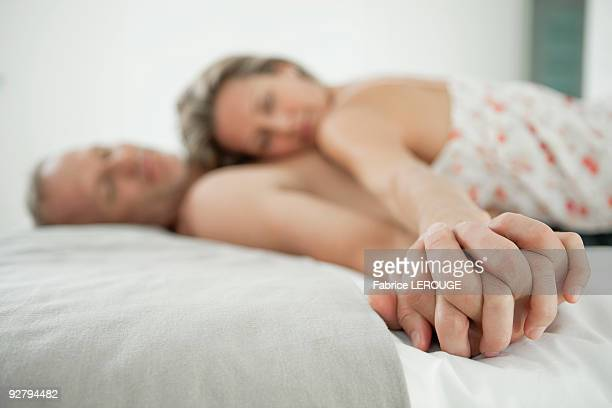 Couple romancing on the bed