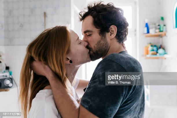 couple romantically engaged in a kiss - love stock pictures, royalty-free photos & images