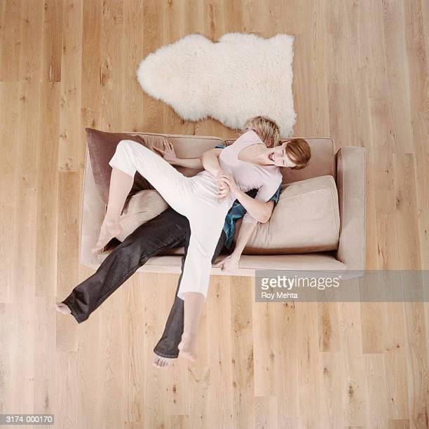 Couple Roughhousing on Sofa