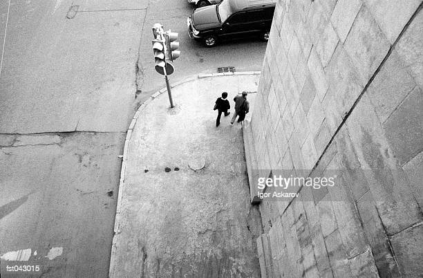 a couple rounding a street corner - corner stock pictures, royalty-free photos & images