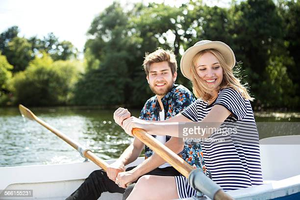 couple rowing boat on lake - romance stock pictures, royalty-free photos & images