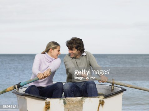 Couple Rowing Boat On Ocean High-Res Stock Photo - Getty ...