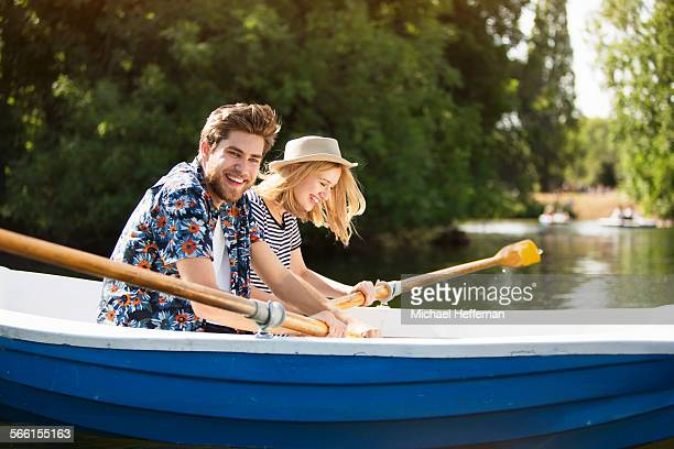 couple rowing boat - romance stock pictures, royalty-free photos & images