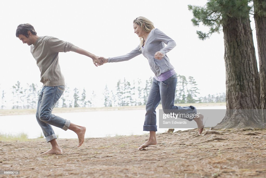 Couple Running And Holding Hands High-Res Stock Photo