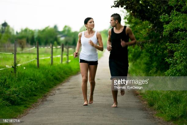 couple running barefoot - barefoot stock pictures, royalty-free photos & images