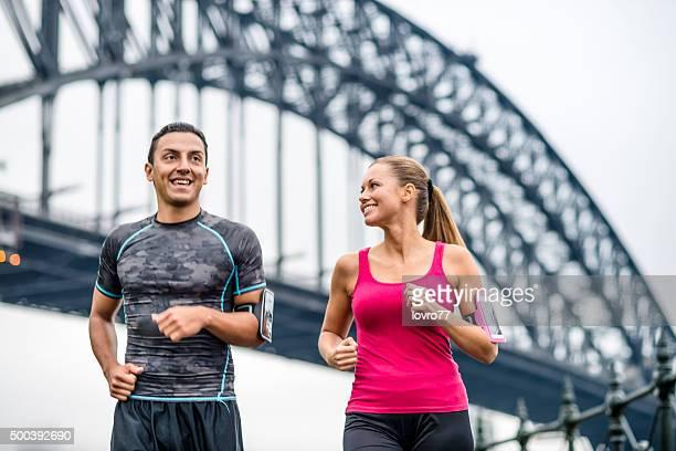 Couple running in Sydney