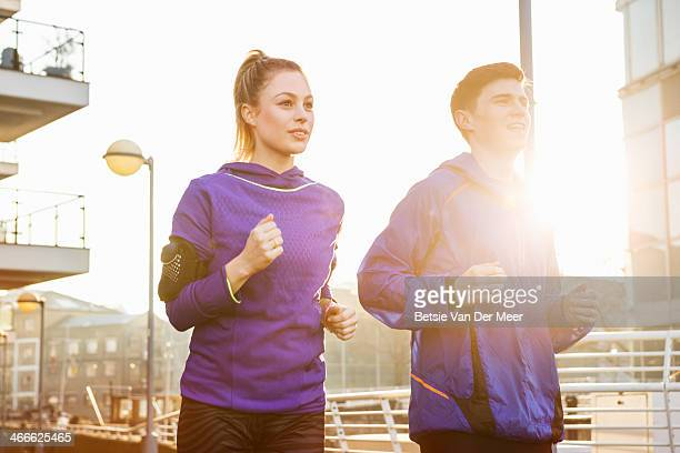 Couple running in urban environment.