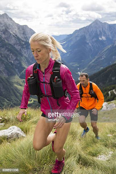 Couple running on mountain