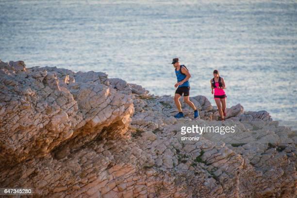 Couple running on mountain