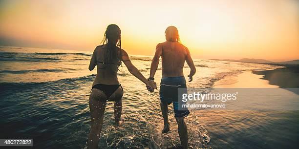 Couple running on the beach