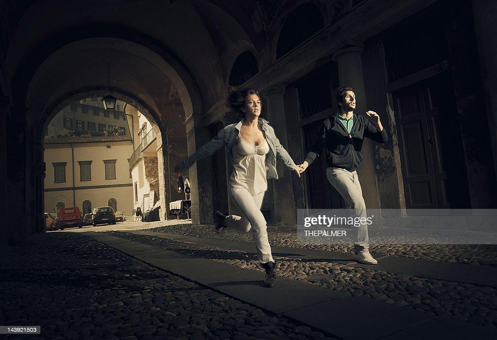 couple running scare : Stock Photo