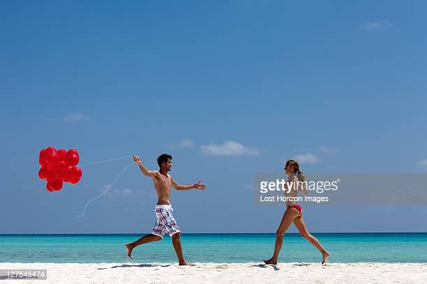 Couple running to each other on beach