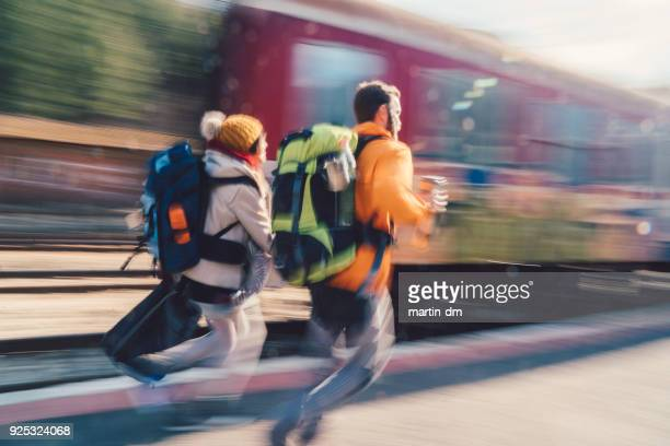 couple running to get on the train - beat the clock stock photos and pictures