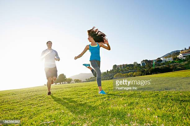 Couple running together in park