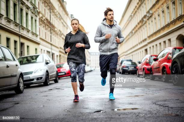 Couple running together in the city