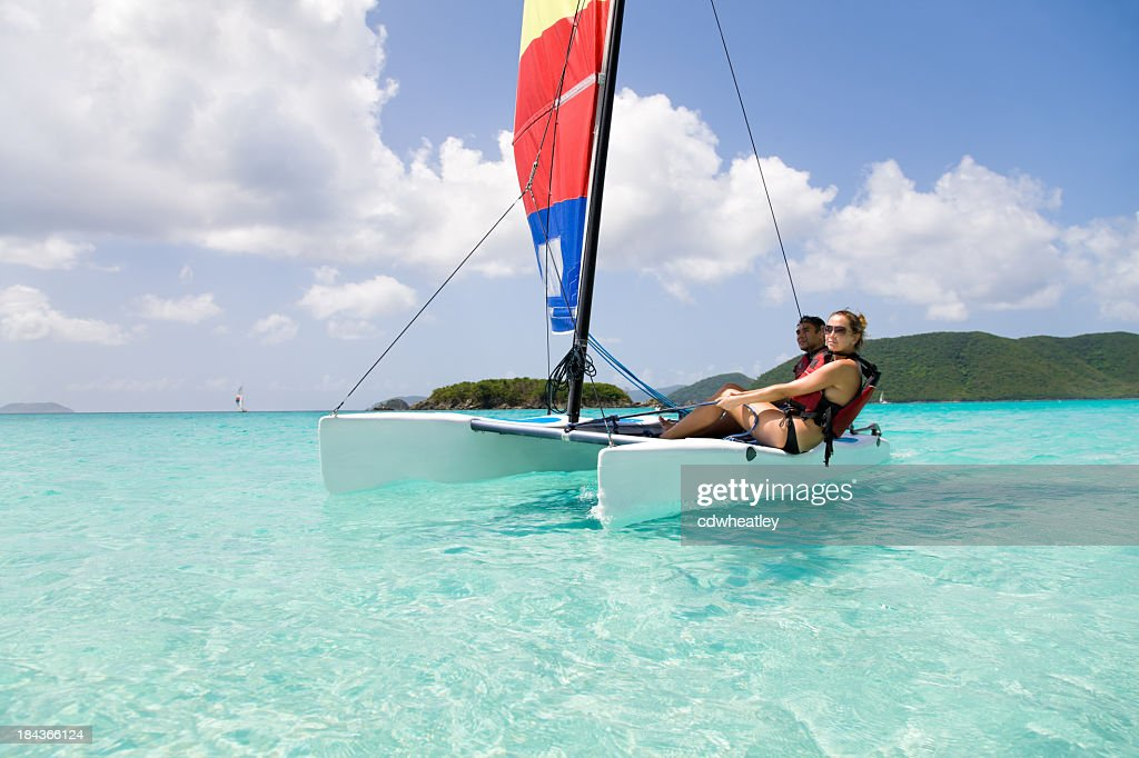 couple sailing a catamaran in the Caribbean : Stock Photo
