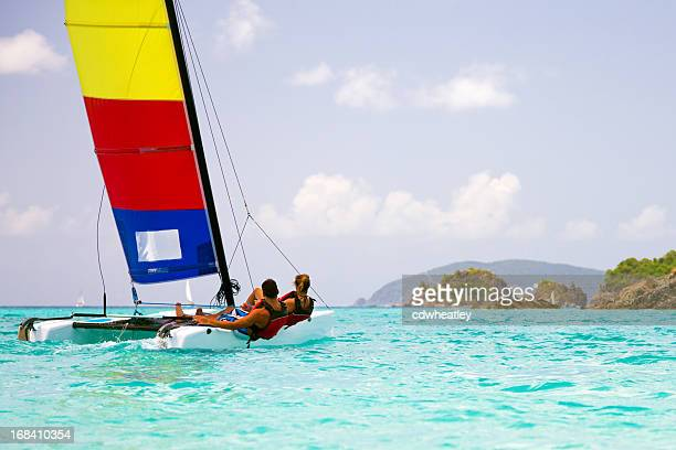 couple sailing a catamaran in the virgin islands - catamaran stock photos and pictures