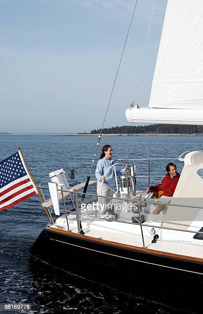 couple sailing at sea, maine - american flag ocean stock pictures, royalty-free photos & images