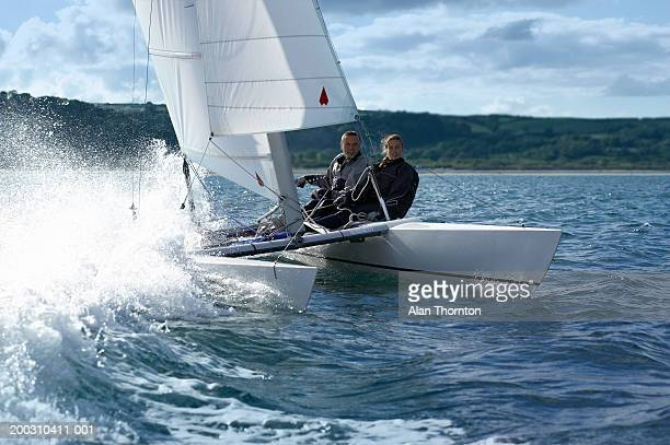 couple sailing catamaran - catamaran sailing stock photos and pictures