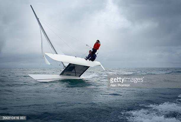 Couple sailing catamaran