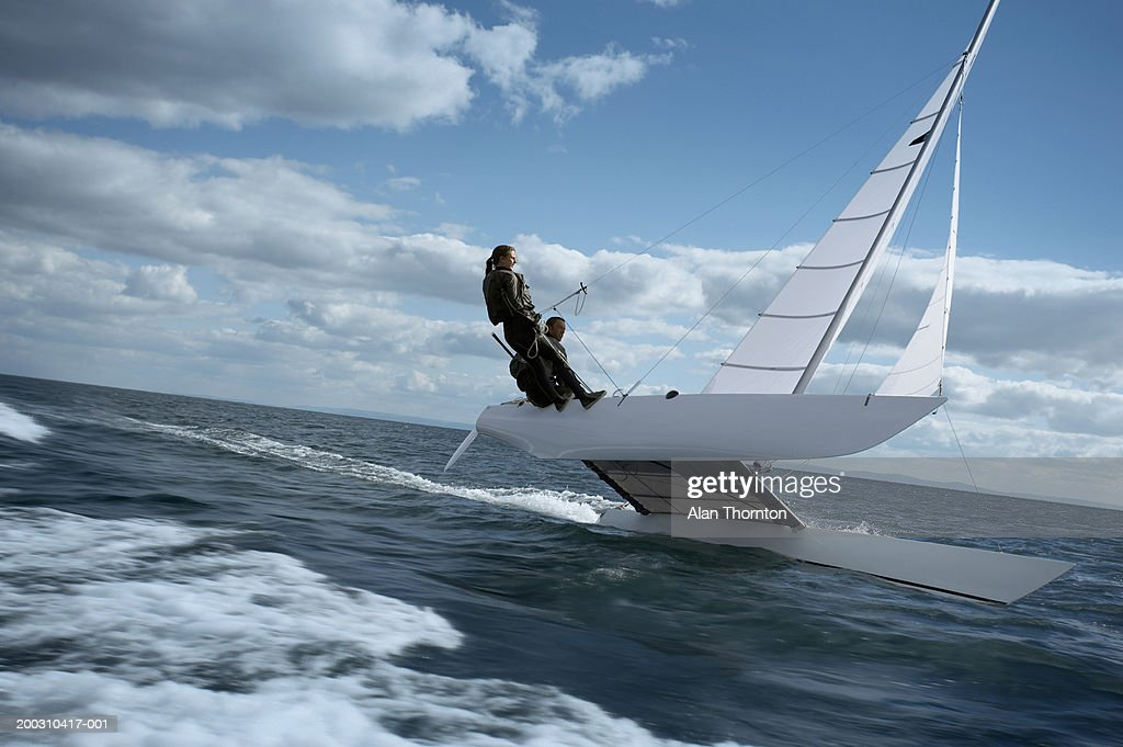 Couple sailing catamaran : Stock Photo
