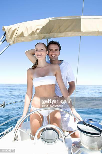 Couple sailing, smiling