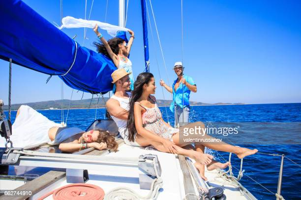 Couple sailing with friends