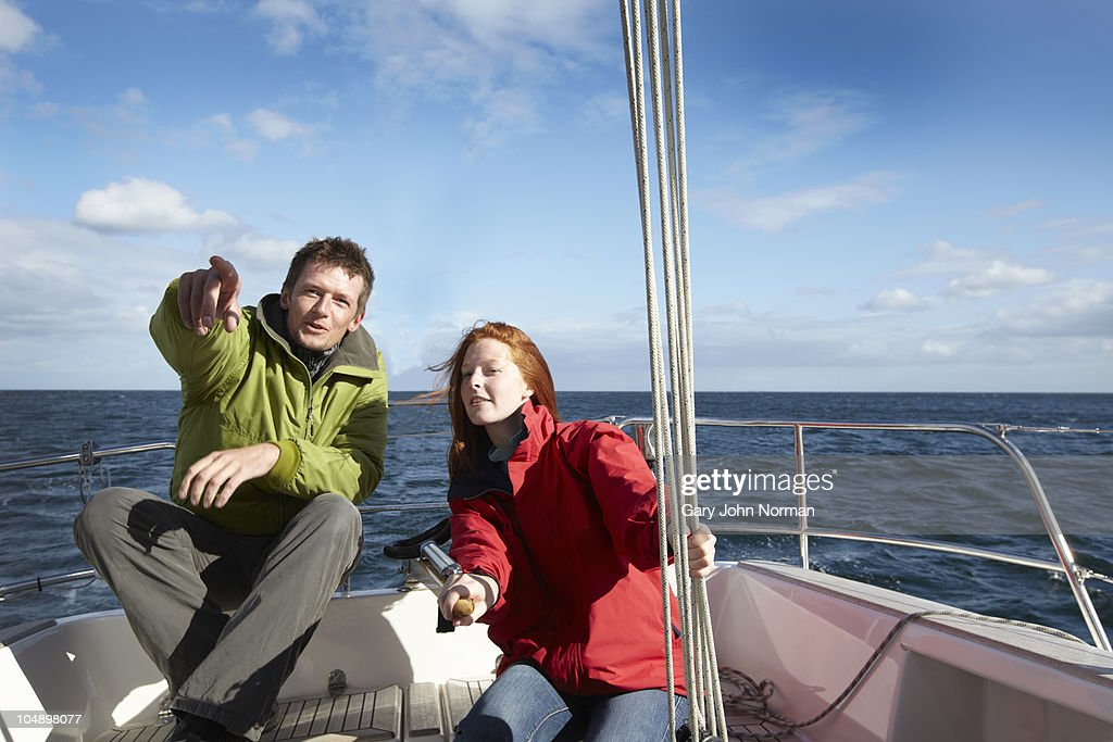 Couple sailing yacht in windy condition summer : Stock Photo