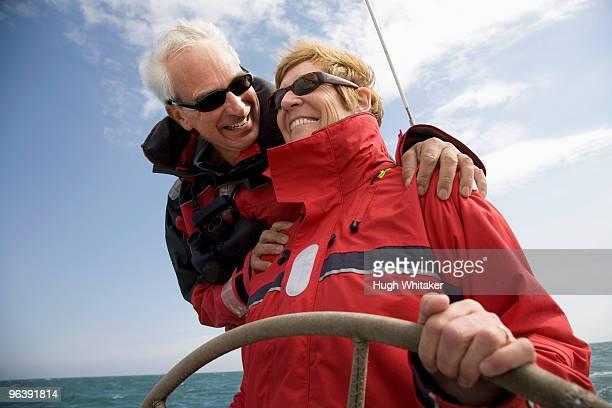 Couple sailing yacht