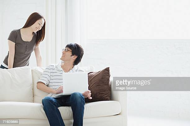 Couple sat in a living room