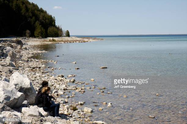 A couple sat on the rocks at Lake Huron