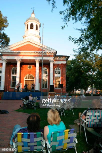 A couple sat watching the Bluemont Summer Concert on the lawn at Old Loudoun County Courthouse