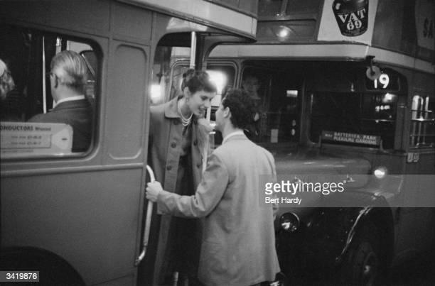 A couple saying goodbye on a bus in Shaftesbury Avenue in London July 1953 Original Publication Picture Post 6576 Known Your Piccadilly pub 4th July...