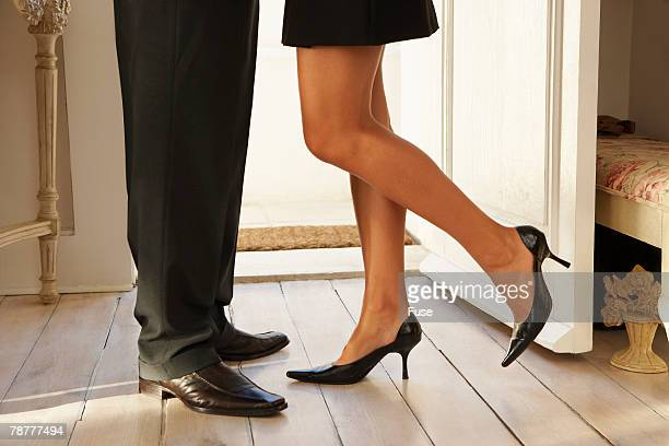 couple saying goodbye - leg kissing stock photos and pictures