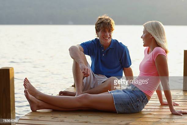 Couple seated on dock
