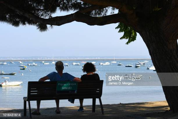 Couple seen gazing into the ocean in Arcachono France on June 20th 2018