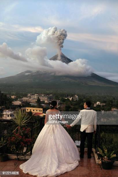 A couple seen getting married near the Mayon volcano as it erupts The Mayon volcano eruption has made tens of thousands of local residents having to...