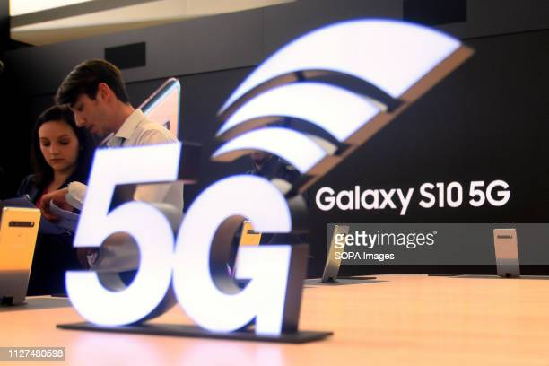 L´HOSPITALET CATALONIA SPAIN A couple seen looking at the new Samsung Galaxy 10 with 5G technology on the Samsung stand during the event at the...
