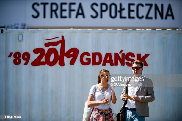 Couple seen next to the official logo at the Solidarity Square during Freedom and Solidarity Days in Gdansk.? Gdansk, in the 1980s became the...