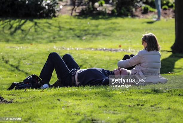 Couple seen relaxing in St James' Park.
