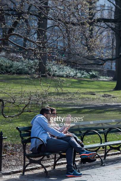 Couple seen taking selfless on Central Park bench in New York City on Feb 28th 2017
