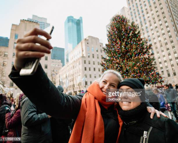 couple selfie in new york - new york city christmas stock photos and pictures